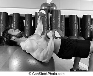 Dumbbell chest press on fit ball man workout
