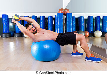 Dumbbell bench press on fit ball man gym workout