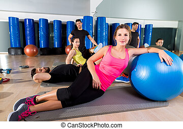 Gym people group relaxed after fitball training - Gym people...