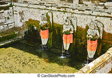 Fountains at Goagajah Temple (The Elephant Cave Temple) in...