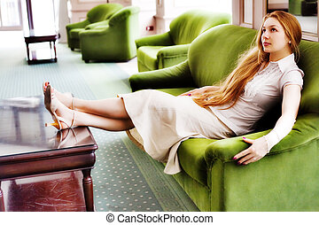 Beautiful woman relaxing on comfortable couch - Beautiful...