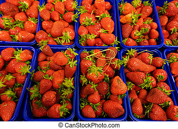 fresh stawberrie.  strawberries in baskets at market