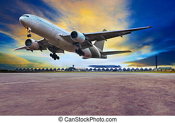 passenger jet plane landing on air port runways against...