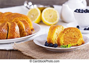 Lemon marble bundt cake served with blueberries