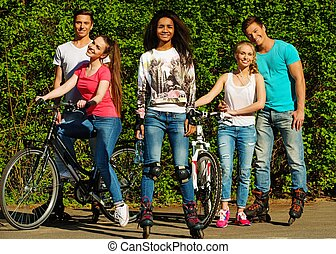 Multi ethnic group of sporty teenage friends in a park