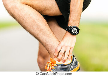 Runners knee pain injury - Runner holding sore leg, knee...