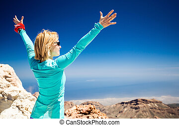 Hiking success, woman on trail in mountains - Hiking woman...