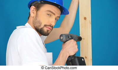 builder drilling into wood