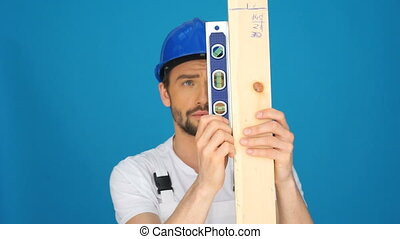 builder measuring using rulers