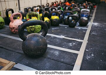 Kettlebell weights at a fitness club - Different sizes of...
