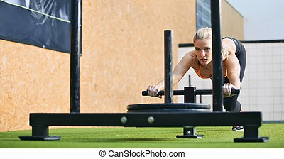 Fit woman exercising to stay - Muscular and strong young...