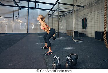 Young fitness female doing crossfit workout - Young fitness...