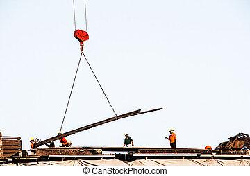 engineer Working cranes inside under gray sky