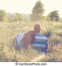 Young couple have romantic date at sunset