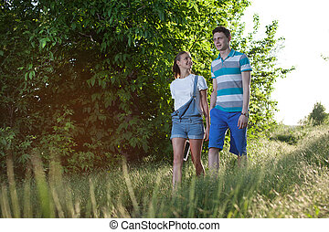 Walking young couple outdoors