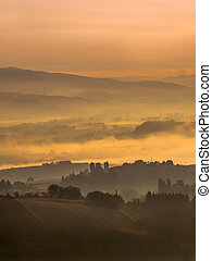 Foggy Sunrise over tuscan Hills