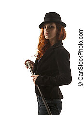 Lady with a stick - Serious red hair lady with a hat and...