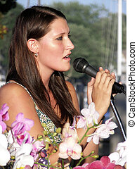 American Idol - Young woman performing outdoors.