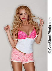 Sexy blonde in a pink bra and pink shorts. - Sexy blonde in...
