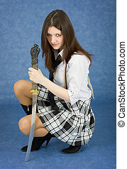 Beautiful girl in a skirt with the Japanese sword in a hand