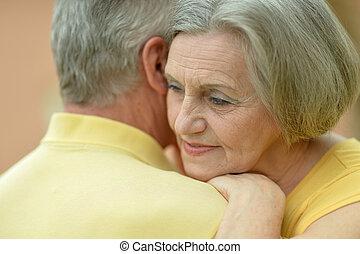 Portrait of a happy cute elderly couple
