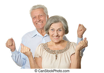 Emotional senior couple isolated on white background