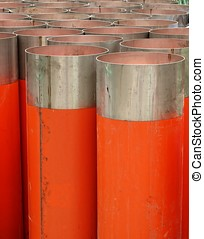 Large Orange Drainage Pipes - Large orange PVC pipes with...