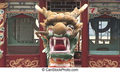 Prow of Dragon Ferry Boat - Brightly painted dragon head on...