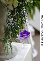 wedding flower decor, puple orchid in water glass