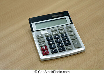 calculator on wood table - black and grey calculator on wood...