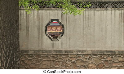 Cutout in Chinese Wall - Peek through window in stone wall,...