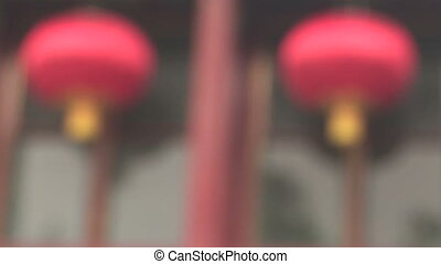 Two Chinese Lanterns Come into Focus - Two hanging red...