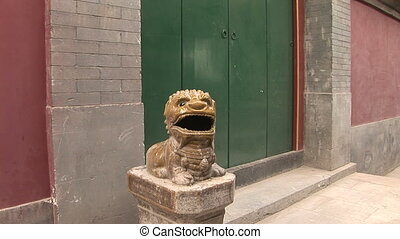 Ceramic Dragon Guarding Door - Glazed ceramic lion statue...