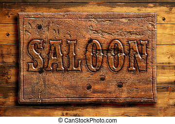 western saloon - signboard of saloon on a wooden wall