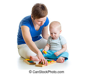 kid and mother play together with puzzle toy