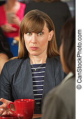 Wide Eyed Woman Listening - Surprised business woman with...