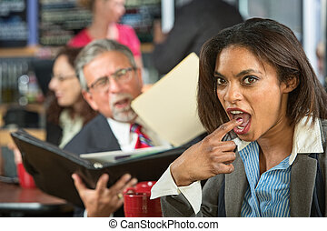 Disgusted Worker with Man - Disgusted business woman gagging...