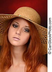 A photo of the beautiful sensual woman with red hair