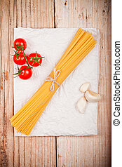 uncooked pasta with tomatoes and garlic