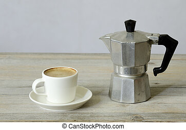 cup of coffee and percolator on wood