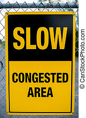 Slow - Congested Area Sign - A yellow caution sign reading:...