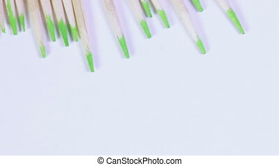 Floss Macro - Toothpicks mint party revolve on white