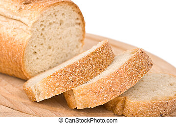 Sliced bread on wooden plate - shallow depth of field