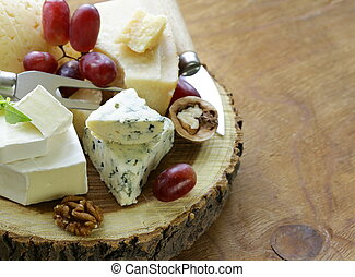 cheeseboard with assorted cheeses parmesan, brie, blue,...