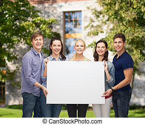 group of standing students with blank white board -...