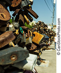 Big old rusty open padlock - Luzhkov bridge in Moscow,...