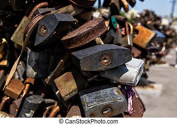 Big old rusty open padlock - Luzhkov bridge in Moscow,...