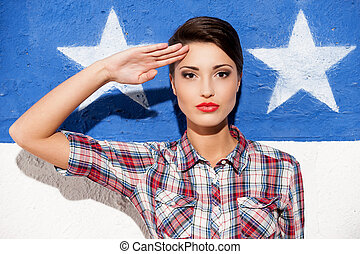 Salute! Fashionable young short hair woman in casual shirt...