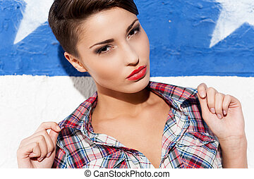 Feeling flirty Fashionable young short hair woman posing...