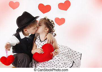 Girl and boy kissing and holding hearts - Lovely girl and...